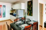 Eating table, fridge and fully equipped kitchenette